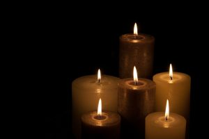 candles lit in the darkness